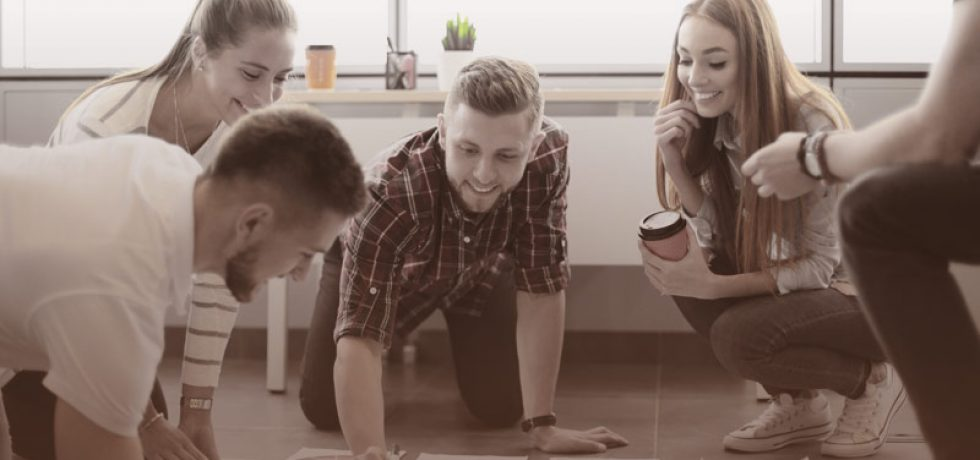 Group of young business people and designers. Men collaborating - ADOBE